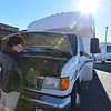 Easy Ride driver Monica Verdin checks fluids in her bus before shuttling seniors at the Broomfield Senior Center on Friday.<br /> January 4, 2013<br /> staff photo/ David R. Jennings