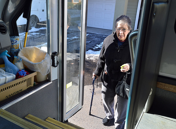Pat Bockenstedt boards the Easy Ride bus for a ride to the Broomfield Senior Center for lunch on Friday.<br /> January 4, 2013<br /> staff photo/ David R. Jennings