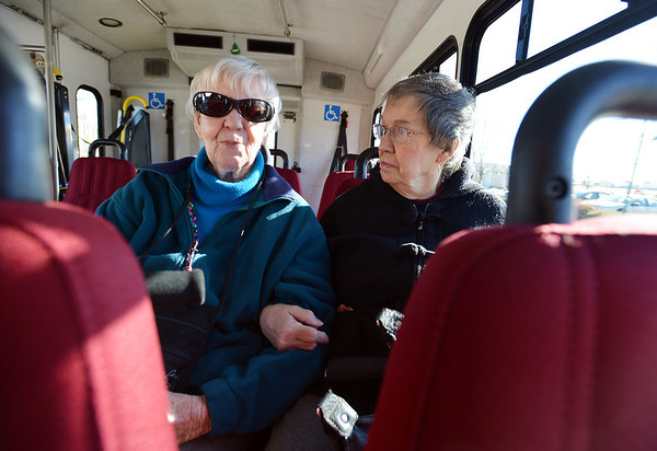 Betty Walker, left, and Pat Bockenstedt ride the Easy Ride bus to the Broomfield Senior Center on Friday.<br /> January 4, 2013<br /> staff photo/ David R. Jennings