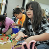 Ariell Gonzalez, 8, fills her basket with candy during the 7-8 year old session of the Eggstravaganza Egg Scramble at the Broomfield Community Center on Saturday.<br /> <br /> April 23, 2011<br /> staff photo/David R. Jennings