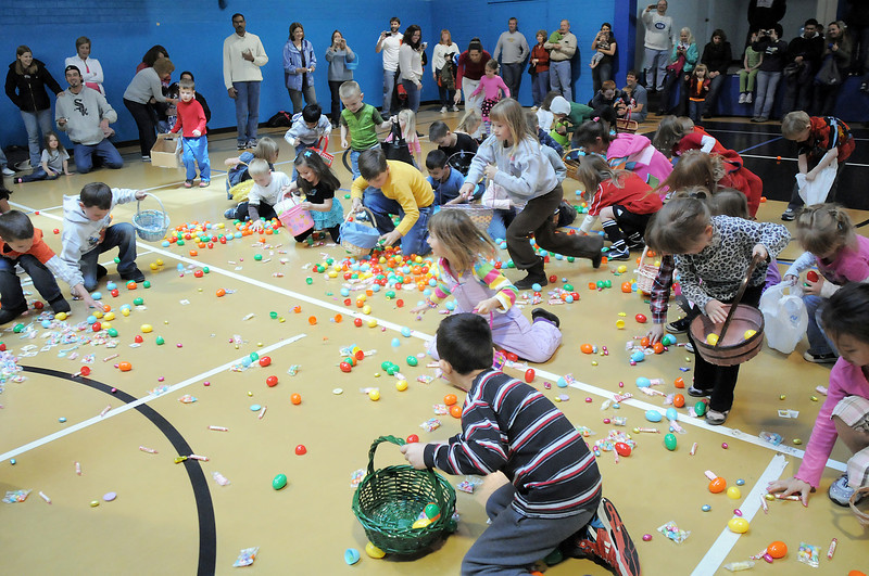 Children in the 5-6 year old session gather candy  during the Eggstravaganza Egg Scramble at the Broomfield Community Center on Saturday.<br /> <br /> April 23, 2011<br /> staff photo/David R. Jennings