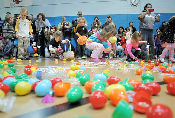 Children in the 3-4 year old session begin to gather goodies during the Eggstravaganza Egg Scramble at the Broomfield Community Center on Saturday.<br /> <br /> April 23, 2011<br /> staff photo/David R. Jennings
