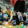 Children fill their basekts with plastic eggs and candy during the 5-6 year old session of the Eggstravaganza Egg Scramble at the Broomfield Community Center on Saturday.<br /> <br /> April 23, 2011<br /> staff photo/David R. Jennings