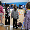 Children in the 3-4 year old session wait for the signal to begin the  egg hunt during the Eggstravaganza Egg Scramble at the Broomfield Community Center on Saturday.<br /> <br /> April 23, 2011<br /> staff photo/David R. Jennings