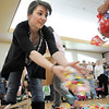 Emily Dattore, 18, tosses candy out for a session during the Eggstravaganza Egg Scramble at the Broomfield Community Center on Saturday.<br /> <br /> April 23, 2011<br /> staff photo/David R. Jennings