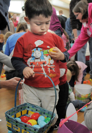 Edward Amsbaugh, 2, examines an eggs while gathering eggs and candy in the 2-3 year old session during the Eggstravaganza Egg Scramble at the Broomfield Community Center on Saturday.<br /> <br /> April 23, 2011<br /> staff photo/David R. Jennings