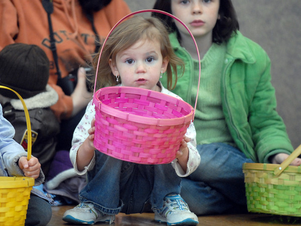 Emmeline Zink, 2, and her sister Cora, 8, wait for the egg scrambles to begin during the Eggstravaganza Egg Scramble at the Broomfield Community Center on Saturday.<br /> <br /> April 23, 2011<br /> staff photo/David R. Jennings