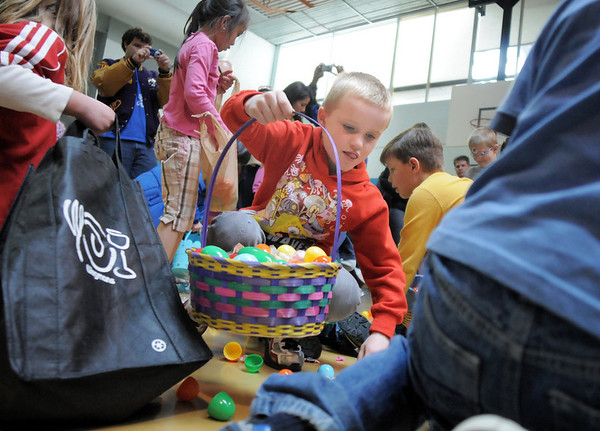 Braden Mullins, 6, gathers candy and plastic eggs in the 5-6 year old session during the Eggstravaganza Egg Scramble at the Broomfield Community Center on Saturday.<br /> <br /> April 23, 2011<br /> staff photo/David R. Jennings