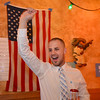 Brayden Portillo gives a cheer at the Broomfield County Democratic party at Corona's restaurant on Tuesday.<br /> <br /> November 6, 2012<br /> staff photo/ David R. Jennings