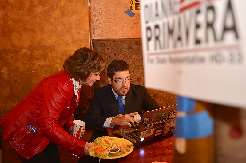 House District 33 candidate Dianne Primavera, left, looks a results with her campaign manager Elliot Goldbaum at the Broomfield County Democratic party at Corona's restaurant on Tuesday.<br /> November 6, 2012<br /> staff photo/ David R. Jennings