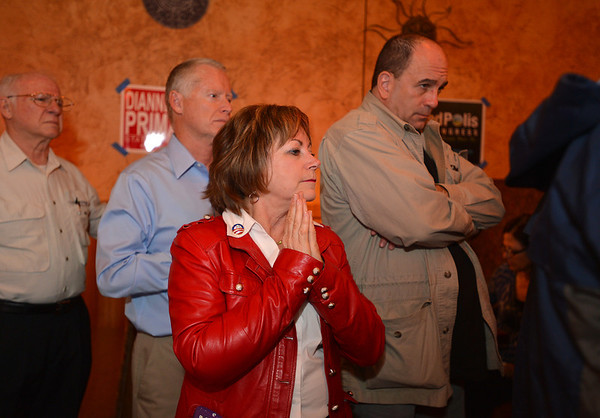 House District 33 candidate Dianne Primavera, center, looks for returns on her race at the Broomfield County Democratic party at Corona's restaurant on Tuesday.<br /> <br /> November 6, 2012<br /> staff photo/ David R. Jennings