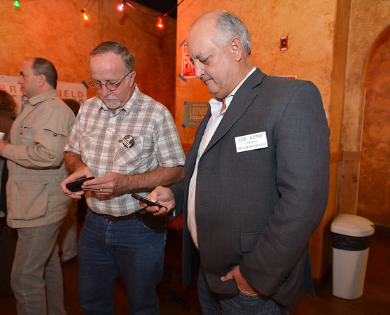 Senate District 23 candidate Lee Kemp, right, and Broomfield councilman Dennis McCloskey look at results on their phones at the Broomfield County Democratic party at Corona's restaurant on Tuesday.<br /> <br /> November 6, 2012<br /> staff photo/ David R. Jennings