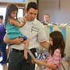 Matt Foster with his daughters Marlo, 4, and Presley, 9, take his ballot to be placed in the tabulating machine at the Broomfield Senior Center on Tuesday.<br /> <br /> November 6, 2012<br /> staff photo/ David R. Jennings