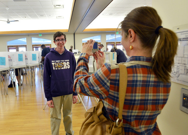 First time voter Kyle Chavez, 18, has his picture taken by his mother Vicki Turos after voting at the Broomfield Senior Center on Tuesday.<br /> <br /> November 6, 2012<br /> staff photo/ David R. Jennings
