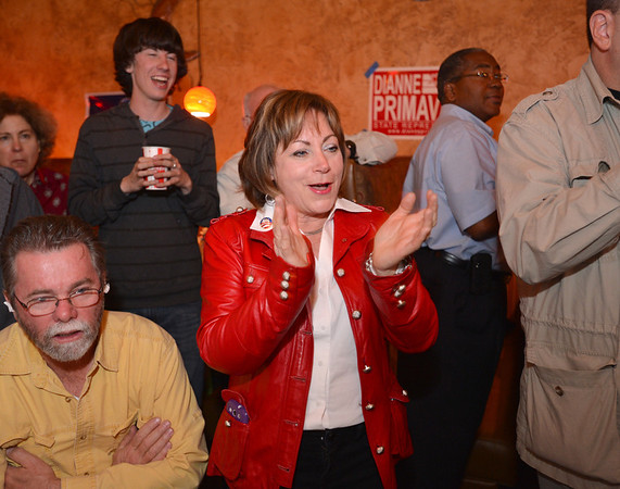 House District 33 candidate Dianne Primavera, center, gives a cheer after see results in her district at the Broomfield County Democratic party at Corona's restaurant on Tuesday.<br /> <br /> November 6, 2012<br /> staff photo/ David R. Jennings