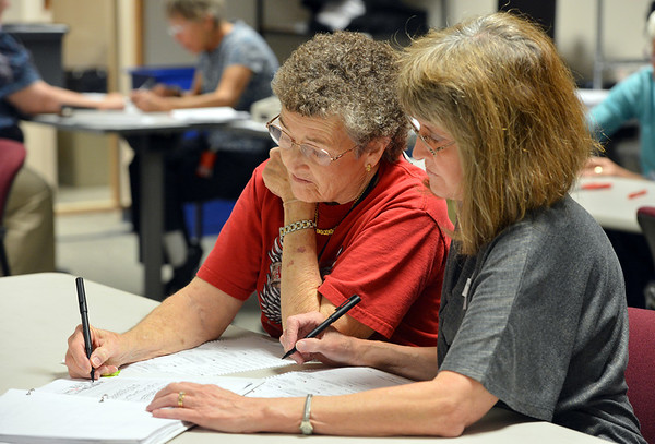 Election judges Doria Willmont, left, and Wendy Fieldermake a duplicate a ballot of a spoiled ballot which could not be read by the machine at the George Di Ciero City and County Buildng on Tuesday.<br /> <br /> November 6, 2012<br /> staff photo/ David R. Jennings