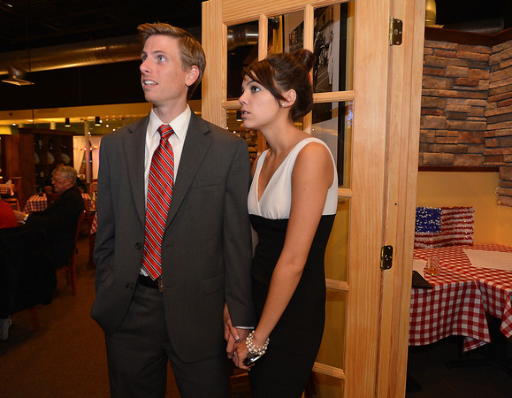 House District 33 candidate David Pigott watches results with his girl friend Charlie Morris by his side at the Broomfield County Republican party at Delvickio's restaurant on Tuesday.<br /> <br /> November 6, 2012<br /> staff photo/ David R. Jennings