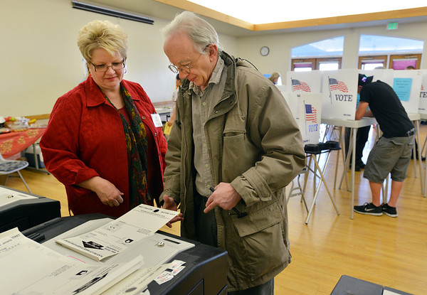 Mark Holder, right, votes with the help of election judge Linda Feigel at the Broomfield Senior Center on Tuesday.<br /> <br /> November 6, 2012<br /> staff photo/ David R. Jennings