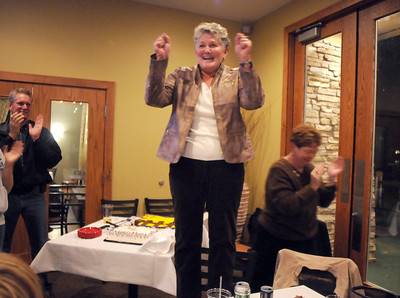 Martha Derda stands on a chair to give a speech during the election night party at Eagle Trace Golf Course on Tuesday. November 3, 2009 Staff photo/David R. Jennings