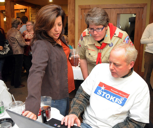 Candidate Liz Law-Evans, center, looks at results with Michele Haedrich, left, and Greg Neece during the election night party at Eagle Trace Golf Course on Tuesday.<br /> November 3, 2009<br /> Staff photo/David R. Jennings