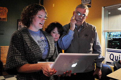 Mayor Pat Quinn, right, looks a results with his wife Carleen, center, and Michelle Bates, Bill Bates campaign manager during the election night party at Legends Grille on Tuesday. November 3, 2009 Staff photo/David R. Jennings