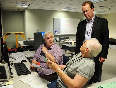 Phyllis Lorimer, left, and Elenore Bergstresser show Broomfield Clerk and Recorder Russ Ragsdale a ballot that is being rejected as they process ballots at the City and County of Broomfield building on Tuesday. November 3, 2009 Staff photo/David R. Jennings