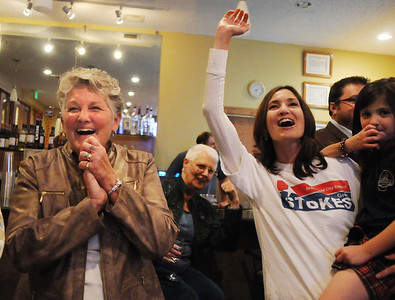 Broomfield council candidate Martha Derda, left, cheers with Jen and her daughter Emily Kuzik, 61/2. as the results are announced during the election night party at Eagle Trace Golf Course on Tuesday. November 3, 2009 Staff photo/David R. Jennings