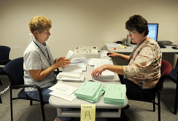 Jean Begaglio, left, and Charlotte Atencio separate ballots from envelopes before counting them at the City and County of Broomfield building on Tuesday.<br /> November 3, 2009<br /> Staff photo/David R. Jennings