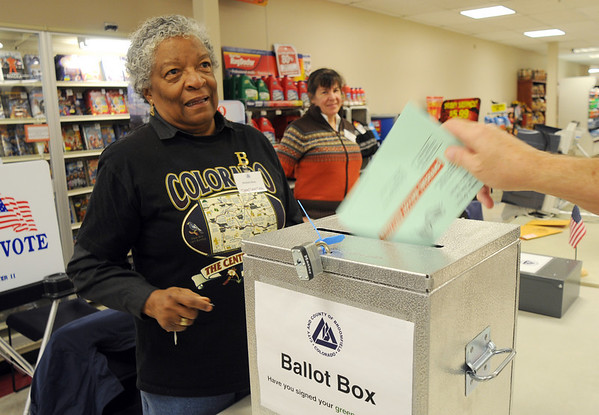 BE1105VOTE06<br /> Election judge Barbara Sloan watches a voter place a ballot in the ballot box at the Miramonte King Soopers on Tuesday.<br /> November 3, 2009<br /> Staff photo/David R. Jennings