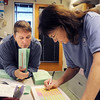 BE1105VOTE02<br /> Marlene Rose Briggs, left, and Loris LeGron record the number of ballots received from a ballot box in the elections office at the City and County of Broomfield building on Tuesday.<br /> November 3, 2009<br /> Staff photo/David R. Jennings