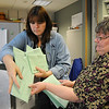 BE1105VOTE04<br /> Penny Norman, left, and Chris Mueller take ballots out of a box for processing at the City and County of Broomfield elections office on Tuesday.<br /> November 3, 2009<br /> Staff photo/David R. Jennings