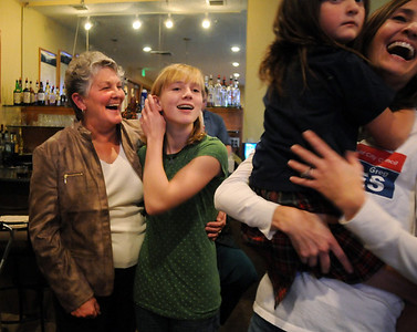Martha Derda, left, celebrates with her niece Kendall Wingfield, 13, during the election night party at Eagle Trace Golf Course on Tuesday. November 3, 2009 Staff photo/David R. Jennings