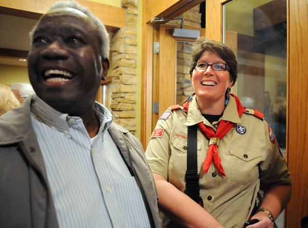 Broomfield Council candidate Liz Law-Evans, right, watches results with Wayne Anderson during the election night party at Eagle Trace Golf Course on Tuesday.<br /> November 3, 2009<br /> Staff photo/David R. Jennings