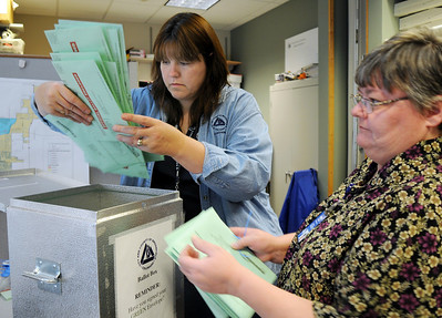 BE1105VOTE03 Penny Norman, left, and Chris Mueller take ballots out of a box for processing at the City and County of Broomfield elections office on Tuesday. November 3, 2009 Staff photo/David R. Jennings