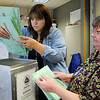 BE1105VOTE03<br /> Penny Norman, left, and Chris Mueller take ballots out of a box for processing at the City and County of Broomfield elections office on Tuesday.<br /> November 3, 2009<br /> Staff photo/David R. Jennings