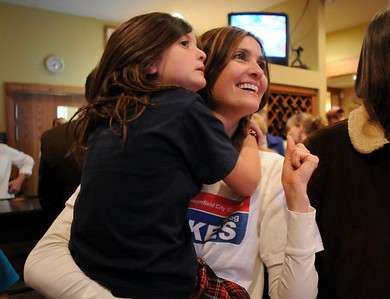 Jen Kuzik watches results with her daughter Emily, 6 1/2 during the election night party at Eagle Trace Golf Course on Tuesday. November 3, 2009 Staff photo/David R. Jennings