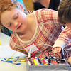 Ashley Trathen, 9, left, and her brother Andrew, 12, figure out a wiring pattern on their circuit board for an experiment during the Electronic Lab taught by Fred Gluck of CU Science Discovery at Mamie Doud Eisenhower Public Library on Saturday.<br /> February 16, 2013<br /> staff photo/ David R. Jennings