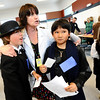 ELLIS04<br /> Erin Shea-Bower, a 5th-grade teacher, drags Sam Taylor, left, and Kaito Salacebo to the next processing station during an Ellis Island re-enactment at Crest View Elementary School on Monday. <br /> Photo by Marty Caivano/Camera/May 10, 2010