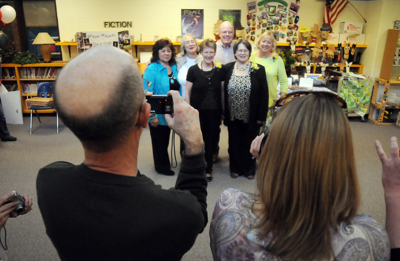 The six Emerald Elementary School retirees , from left, Carol Silvia, Chris Snyder, Cindy Stricker, Larry Leatherman, Diana Wetzel and Jan Kardatzke pose for pictures during Friday's retirement party.<br /> May 7, 2010<br /> Staff photo/ David R. Jennings