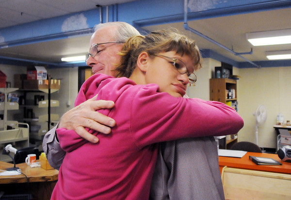 Principal Larry Leatherman, left, and former student Gabrielle Gonzales, 16, hug during Friday's retirement party for six Emerald Elementary School staff at the school.<br /> May 7, 2010<br /> Staff photo/ David R. Jennings