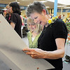 Cindy Stricker, right, looks at a card made by student Molly Conroy, 9, during Friday's retirement party at Emerald Elementary School.<br /> May 7, 2010<br /> Staff photo/ David R. Jennings
