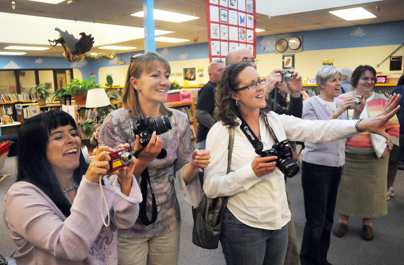 Friends and family members direct retirees for a group picture during Friday's retirement party at Emerald Elementary School.<br /> May 7, 2010<br /> Staff photo/ David R. Jennings