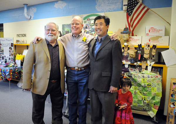 Former, retiring and new principals of Emerald Elementary School John Ortner, left, Larry Leatherman and David Tanaka with his daughter Ruby Jane, 2, pose for pictures during Friday's retirement party.<br /> May 7, 2010<br /> Staff photo/ David R. Jennings