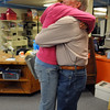 Principal Larry Leatherman, left, is hugged by former student Gabrielle Gonzales, 16, in the library during Friday's retirement party for six Emerald Elementary School staff at the school.<br /> May 7, 2010<br /> Staff photo/ David R. Jennings