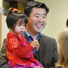 The new Emerald Elementary School principal David Tanaka with his daughter Ruby Jane, 2, chat with attendees during Friday's retirement party.<br /> May 7, 2010<br /> Staff photo/ David R. Jennings