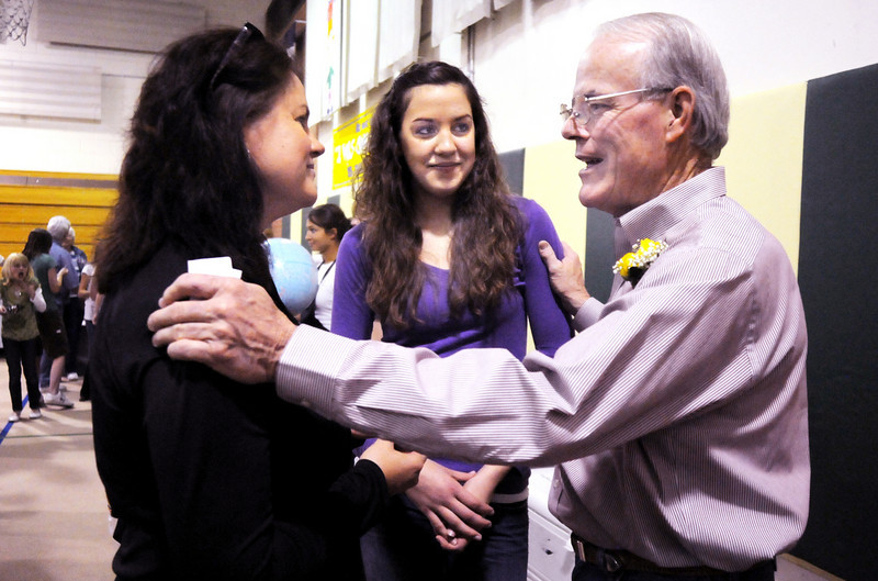 Retiring Emerald Elementary School principal Larry Leatherman, right, talks with former student Katie Nehf, center and her mother Patti during Friday's retirement party at the school.<br /> May 7, 2010<br /> Staff photo/ David R. Jennings