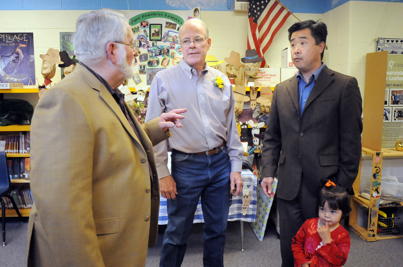 Former, retiring and new principals of Emerald Elementary School John Ortner, left, Larry Leatherman and David Tanaka with his daughter Ruby Jane, 2, chat during Friday's retirement party.<br /> May 7, 2010<br /> Staff photo/ David R. Jennings