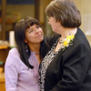 Retiring school secretary Diana Wetzel, right, chats and hugs Eugenia Brady during Friday's retirement party at Emerald Elementary School.<br /> May 7, 2010<br /> Staff photo/ David R. Jennings