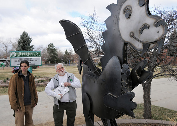 Former Emerald Elementary principal John Ortner, right,  looks at the steel sculpture of Snortner, the school's mascot, with artist Chapin Diamond after the dedication at the school on Thursday. Snortner is named after John Ortner. <br /> <br /> March 31, 2011<br /> staff photo/David R. Jennings
