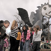 Emerald Elementary School students gather around the sculpture of Snortner, the school's mascot, while preparing to be photographed after the dedication on Thursday. Snortner is named after John Ortner. <br /> <br /> March 31, 2011<br /> staff photo/David R. Jennings